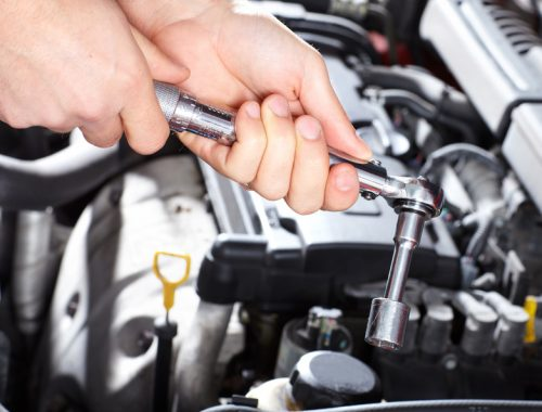 Hand with wrench. Mechanic. Auto repair shop.